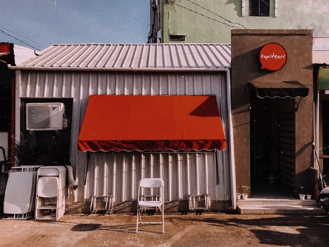 Clean red awnings fabric installed in a closed restaurant