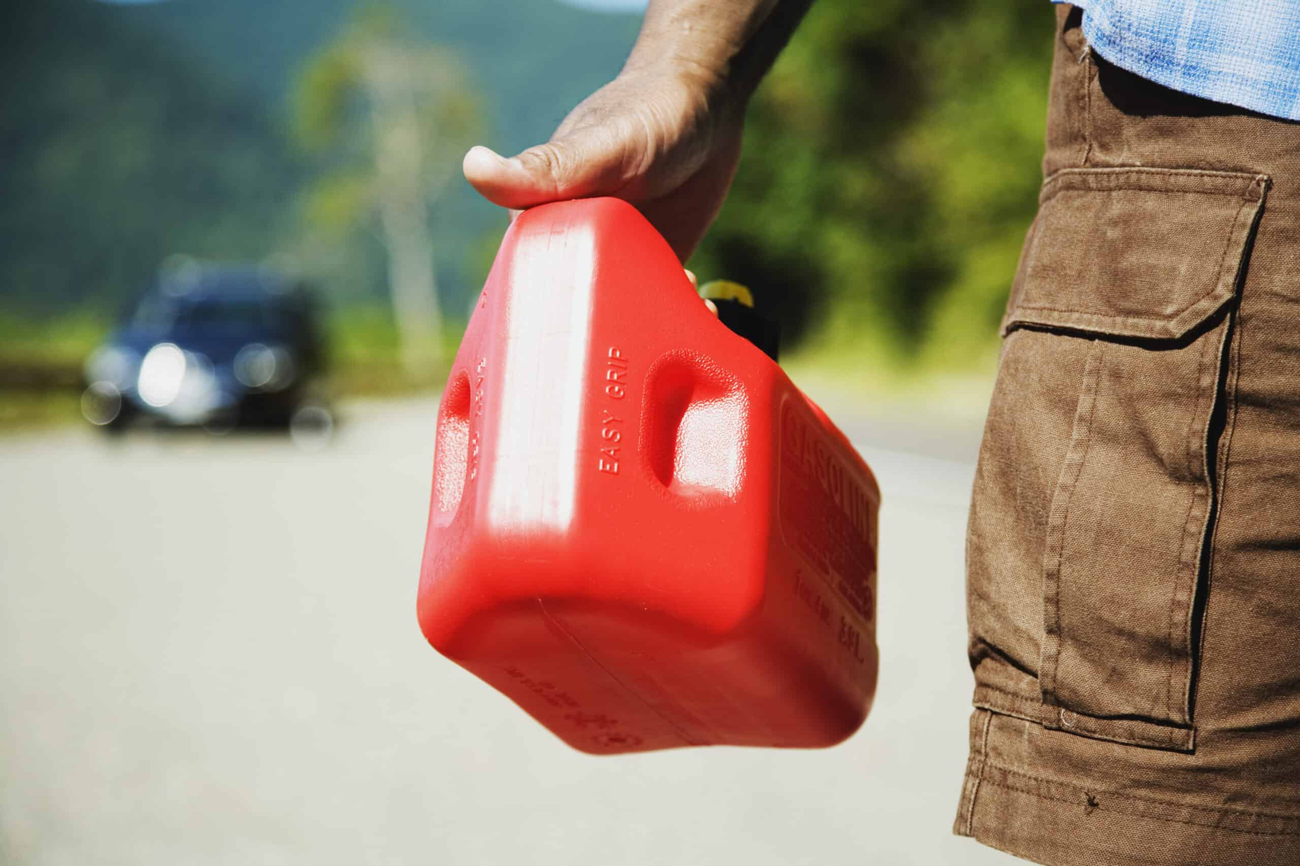 Man holding clean gas can