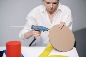 Woman using a glue gun for her crafts