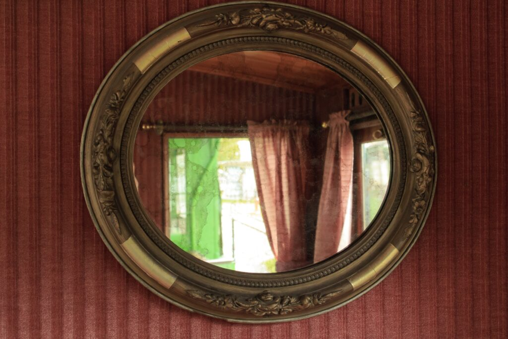An oval shaped antique mirror