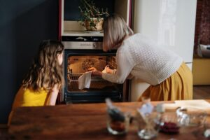 Mother and child using a clean oven