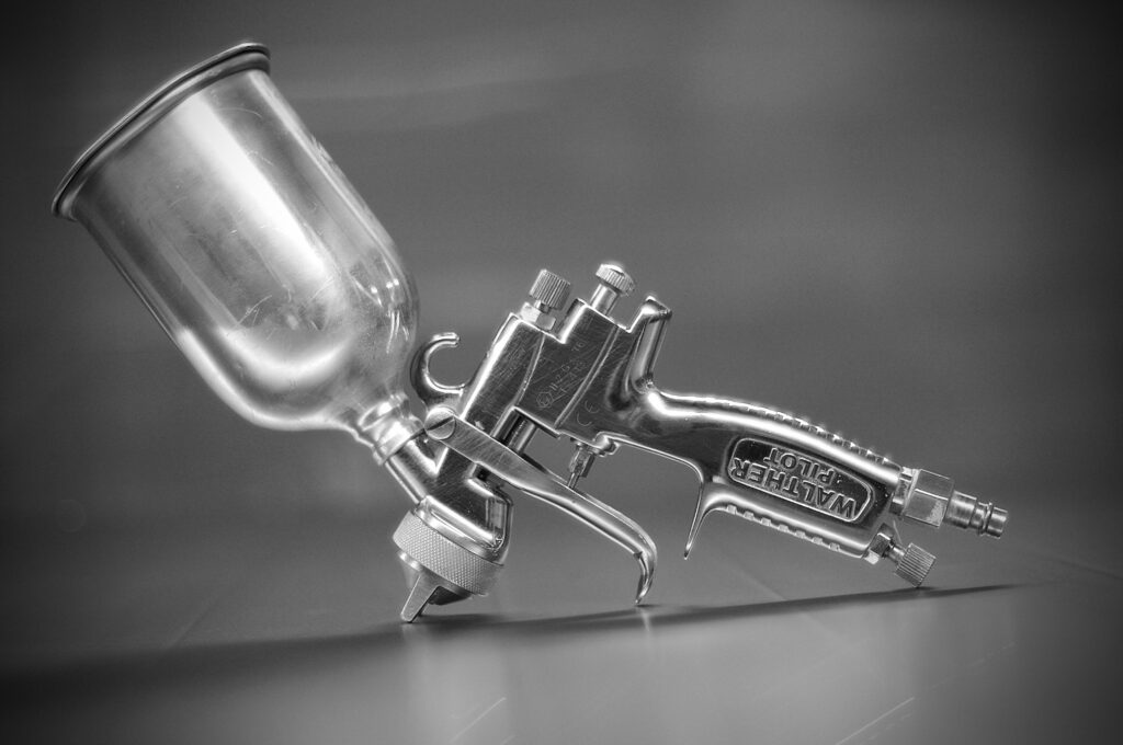 A stainless steel spray paint gun on display