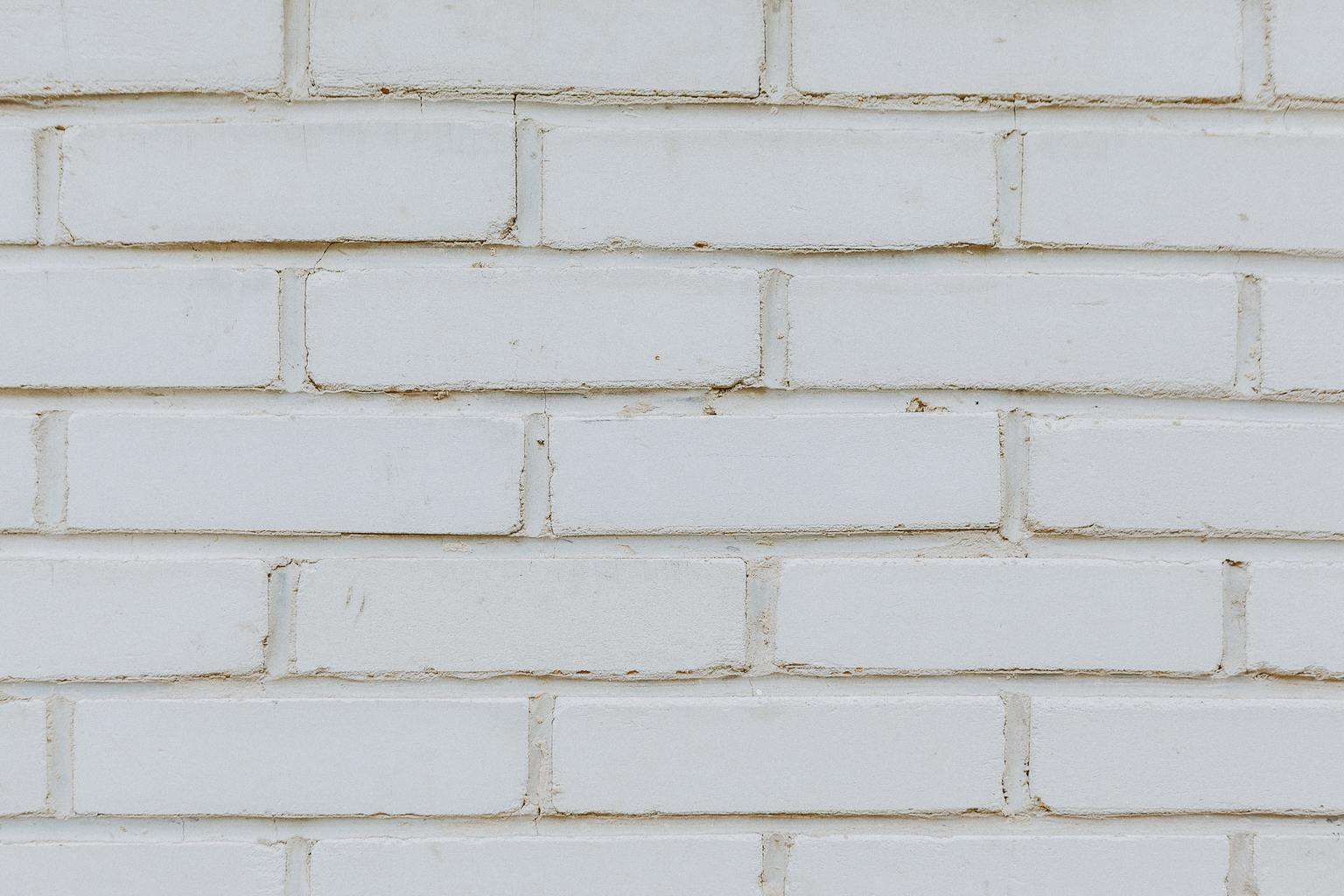 A white painted brick wall with stains
