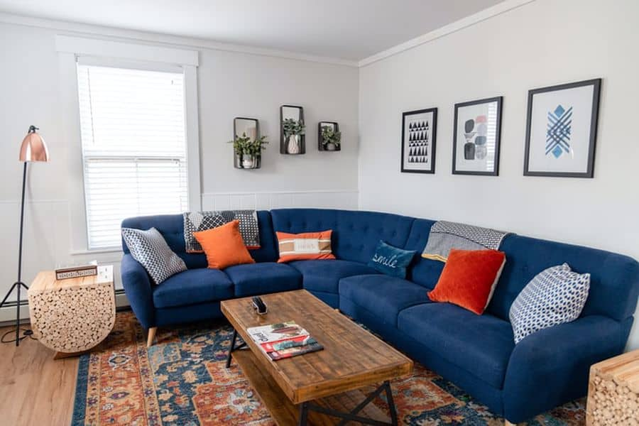 Blue couch with polypropylene rug