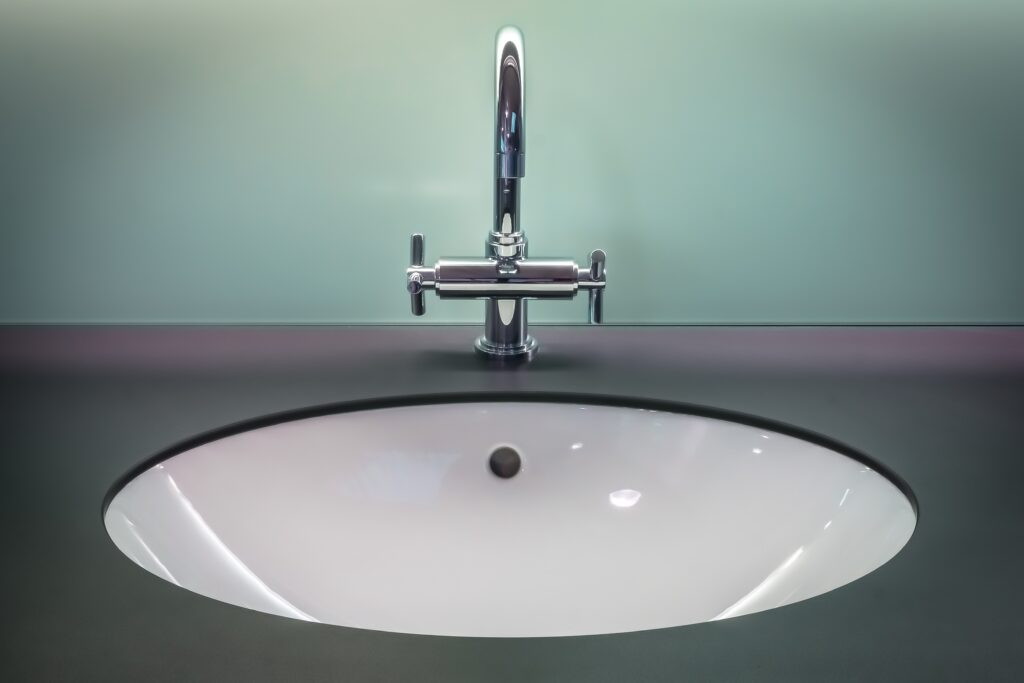 A bathroom sink with a sink overflow