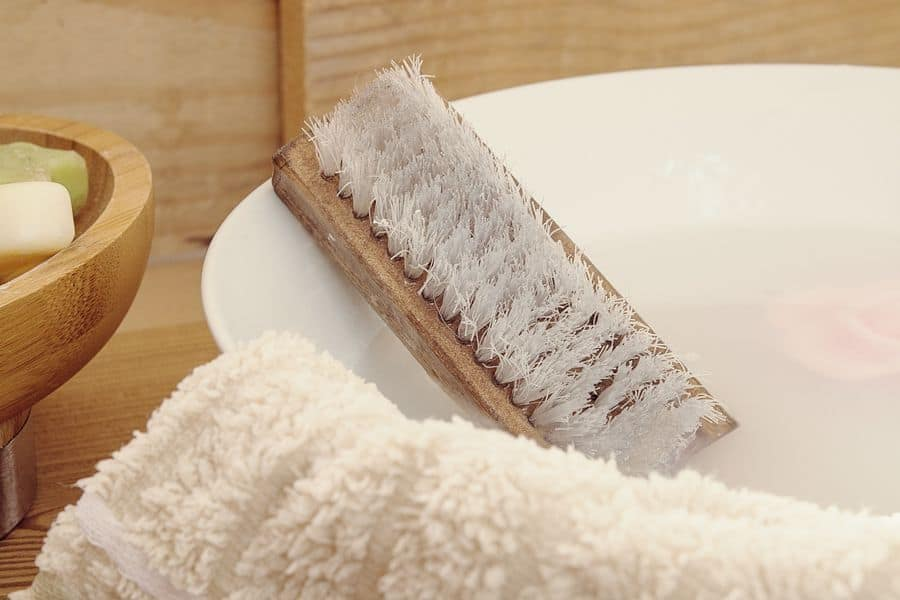 Bowl of water, towel and cleaning brush