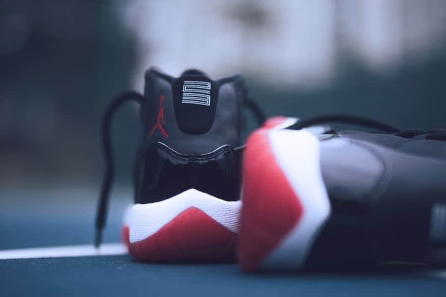 Jordan 11 shoes placed on the ground