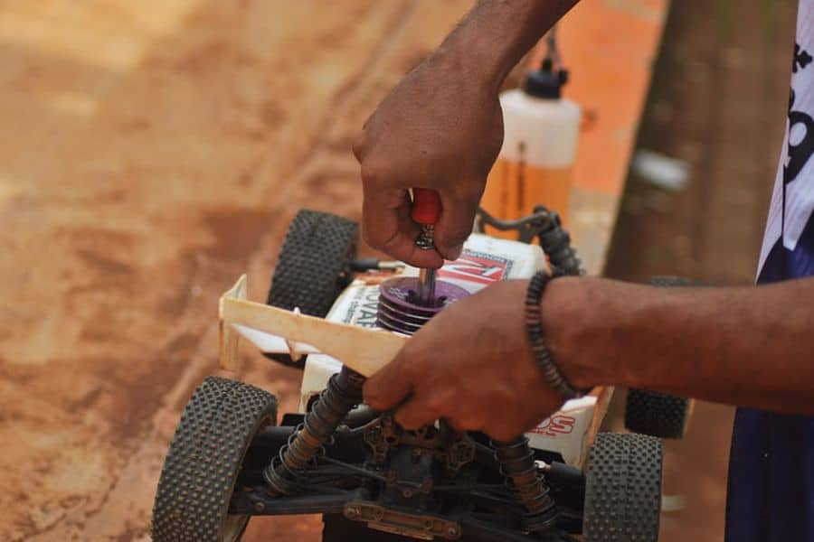Person tinkering with an RC Car
