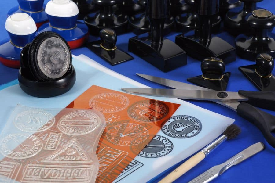 Clear stamp cut outs, scissor and ink stamp on the table
