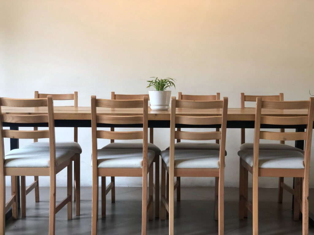 Wooden dining table with cushioned dining chairs