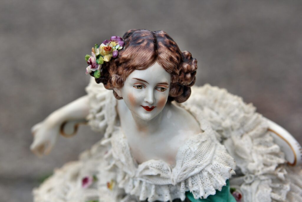 A porcelain figurine of a woman in a white dress