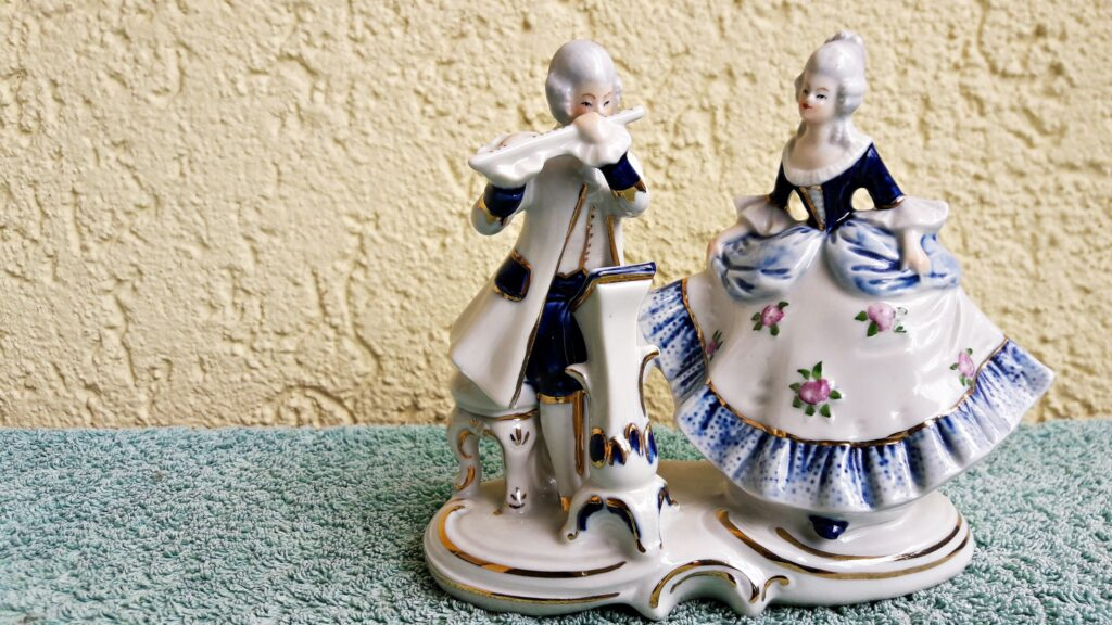 A shiny white porcelain figurine of two persons