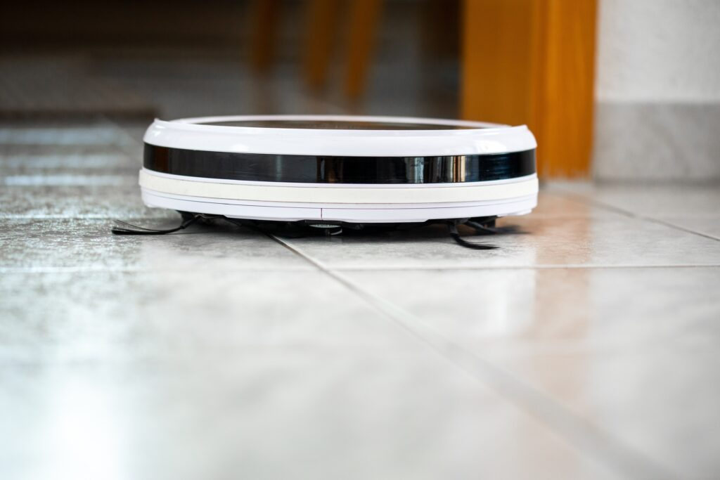 A worm view of a robot vacuum cleaning the floor