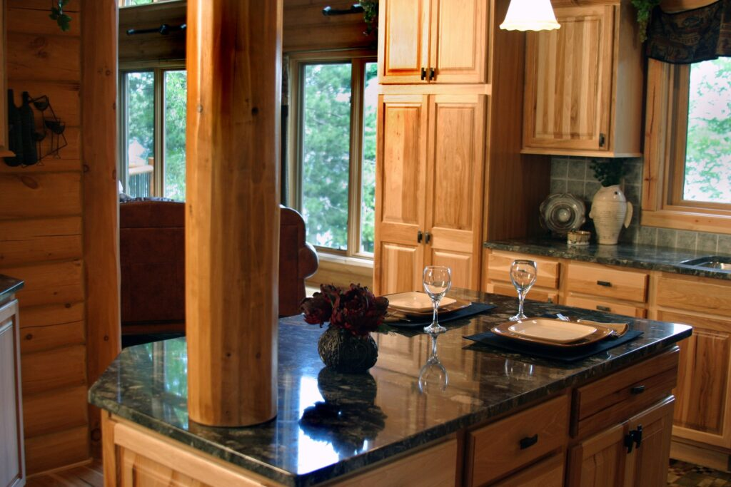 A marble countertop with wooden cabinets and a column