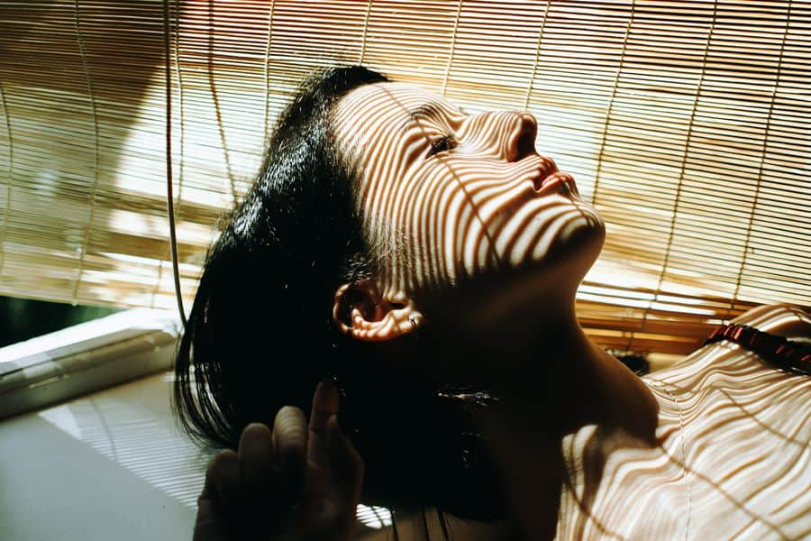 Woman lounging and enjoying her newly cleaned bamboo blinds