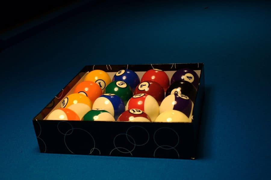 Newly cleaned billiard balls stored in a box