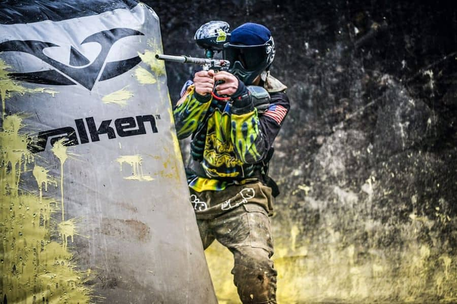 Man playing paintball while wearing full gear