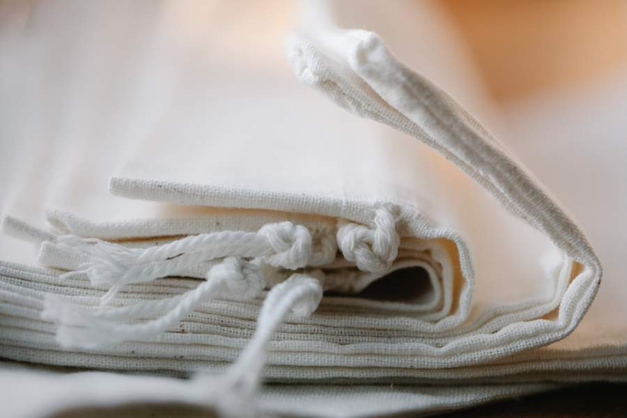 Close up of a pile of nut milk bags