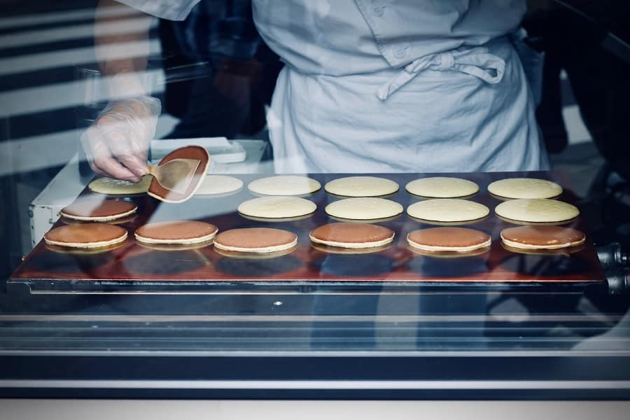 Person cooking pancakes using an electric griddle