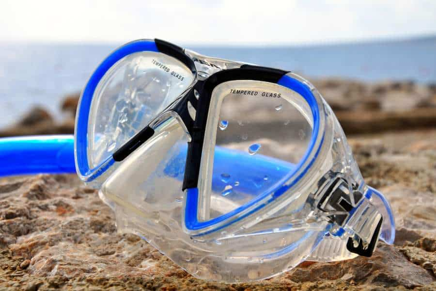 A snorkel mask on the sand