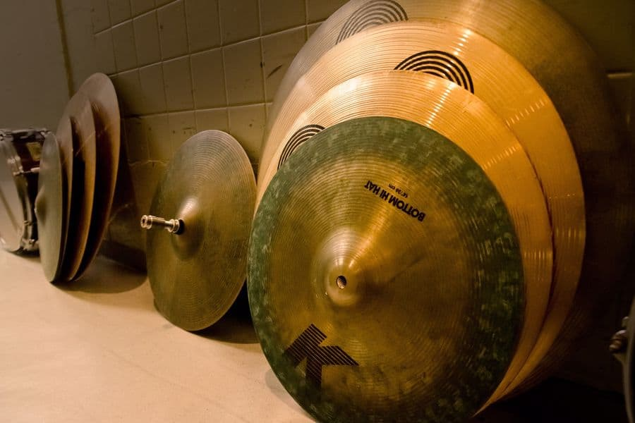 Clean cymbals stored on the side of a room