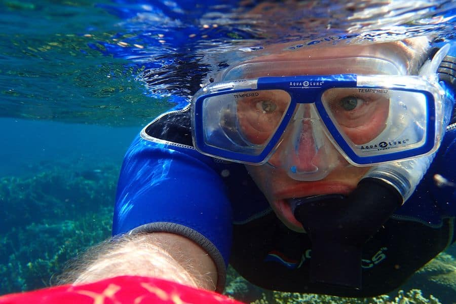 Person snorkeling under water